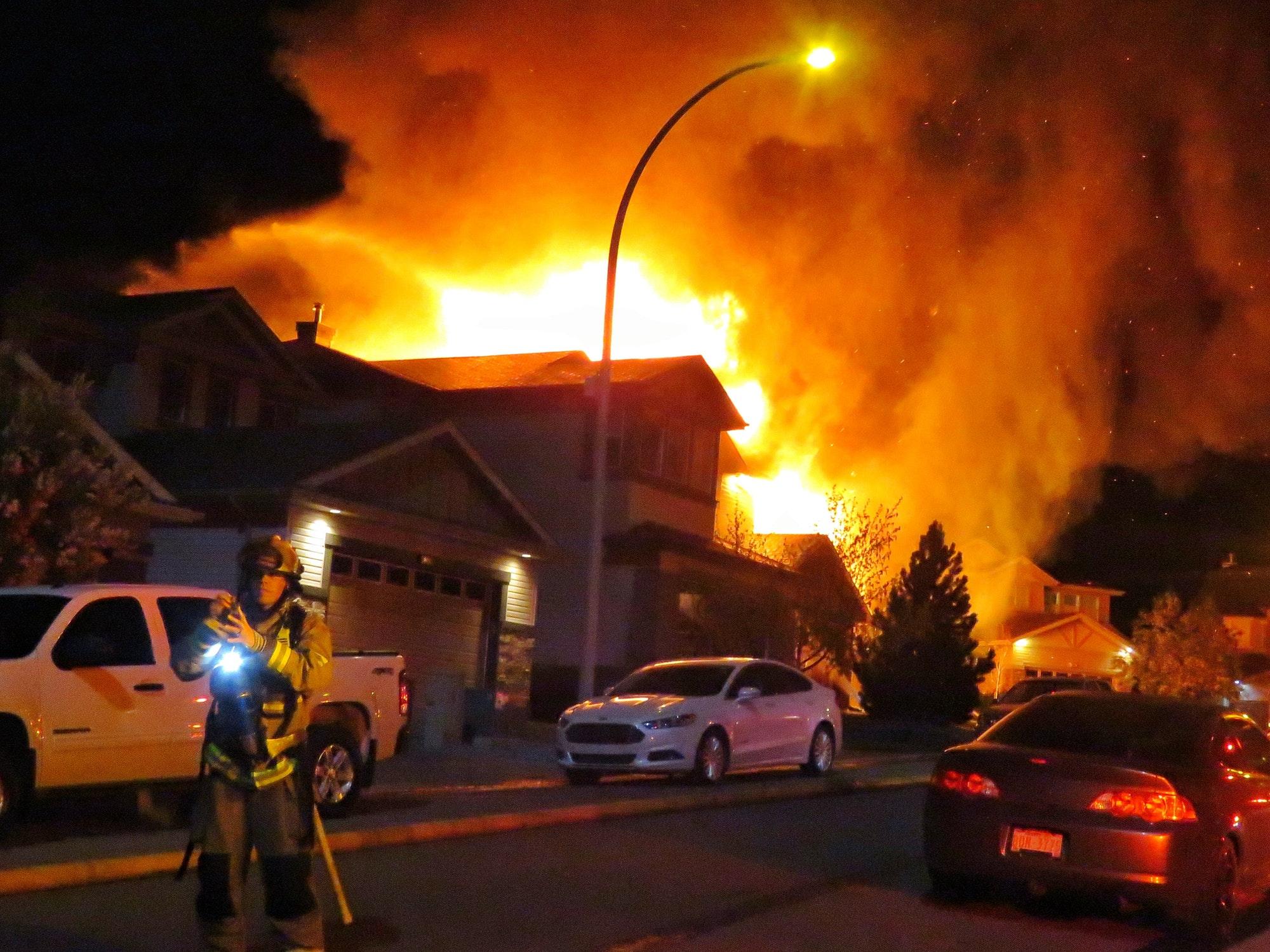 Calgary Firefighters battle an early morning house fire in Royal Oak.