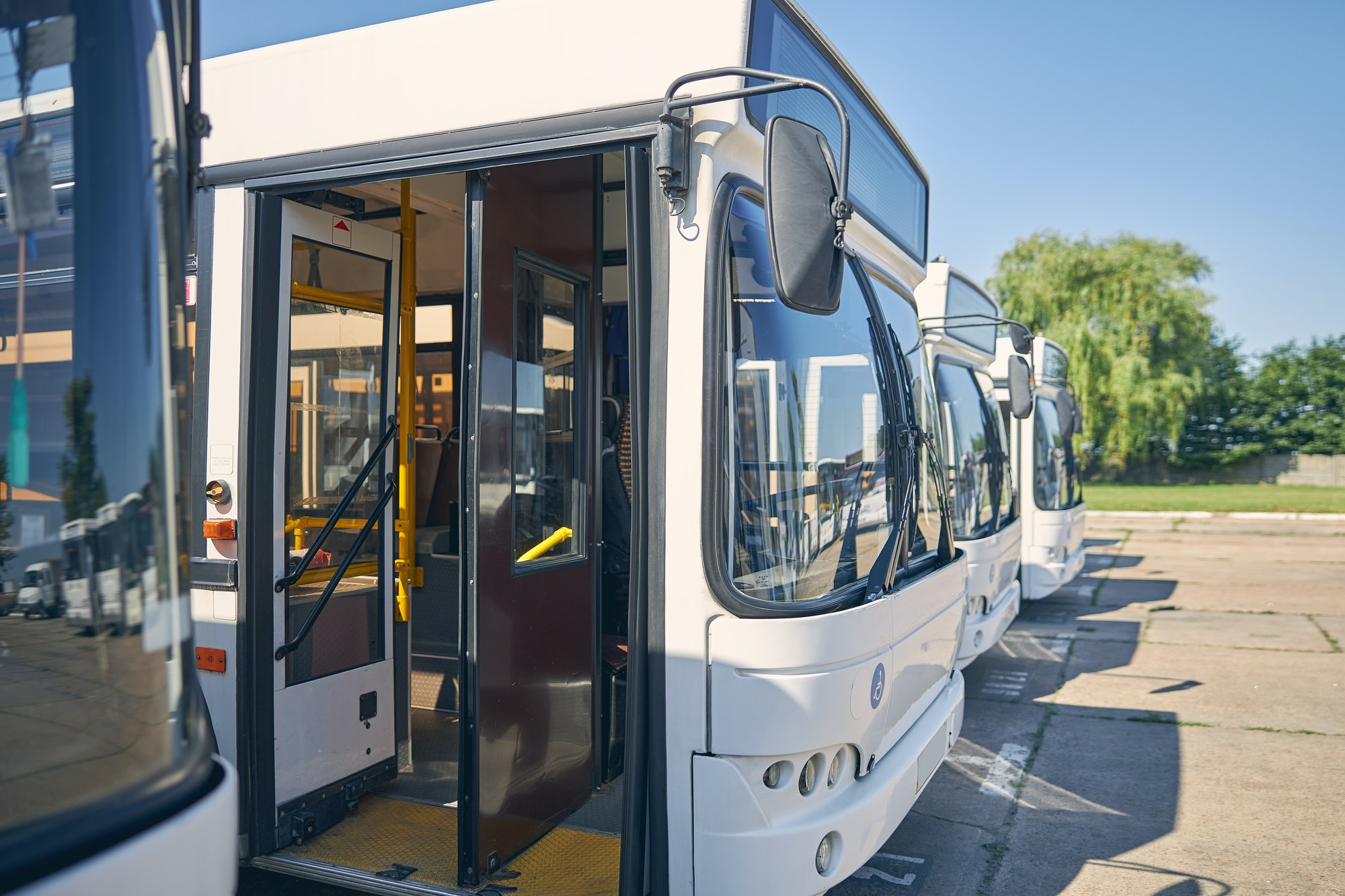 Close up of white bus with opened doors